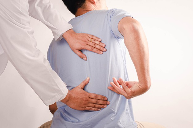 doctors doing physical therapy young men advise patient with back waist problems 73749 637 1