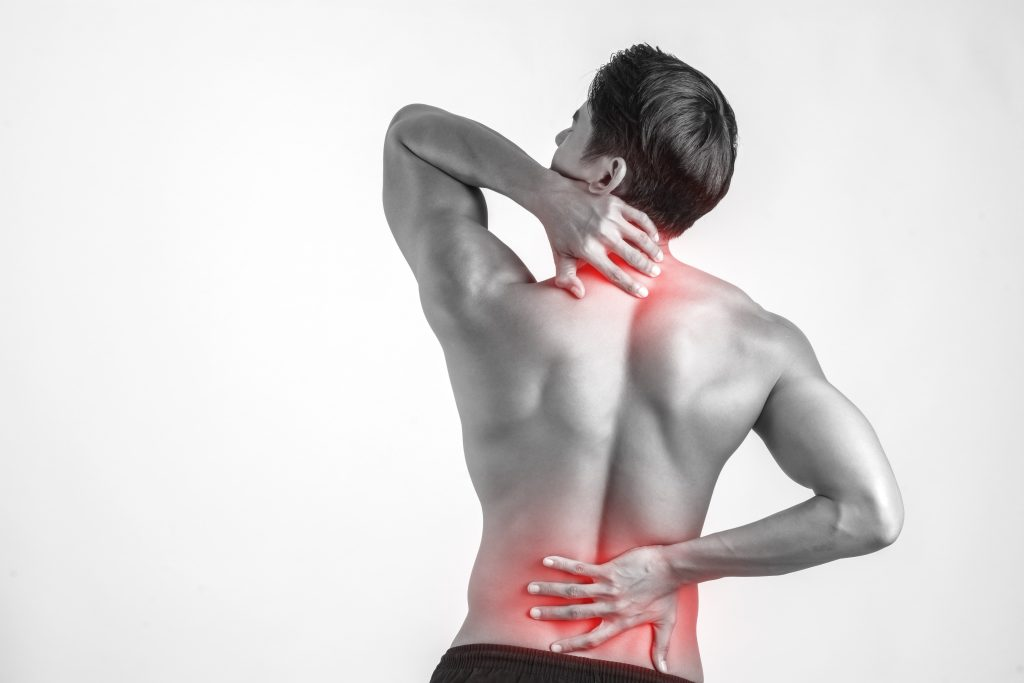 close up man rubbing his painful back isolated white background 1