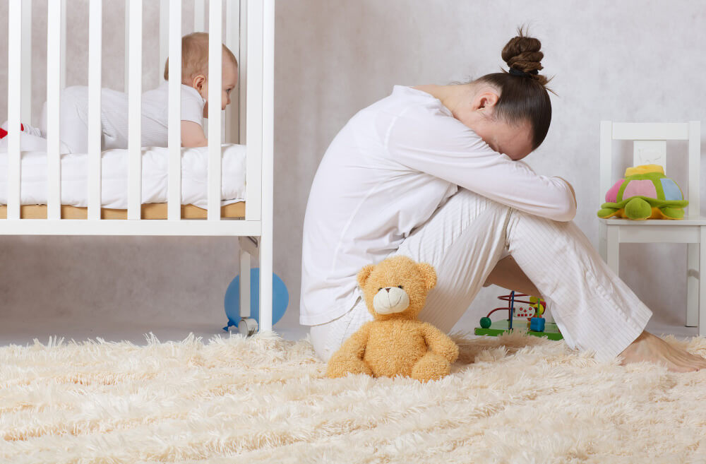 young mother 30 40 years old is experiencing postnatal depression 1